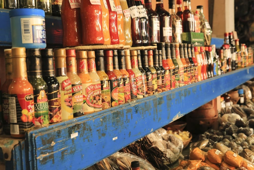 Colorful bottles on a blue shop shelf in St. Lucia