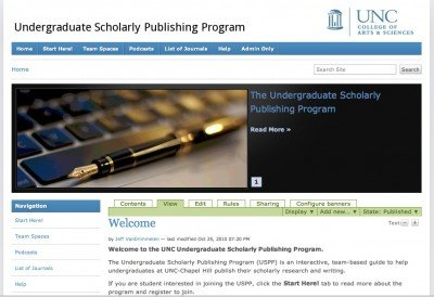 The home page of the Undergraduate Scholarly Publishing Program, which features an image of a laptop keyboard with a black and gold fountain pen lying across it.