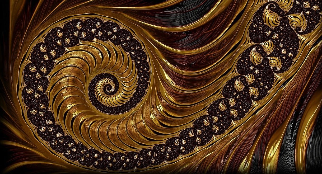 Alt text: a photographic image of a fractal in brown and gold tones, spiraling counter-clockwise. Image via Pixabay.
