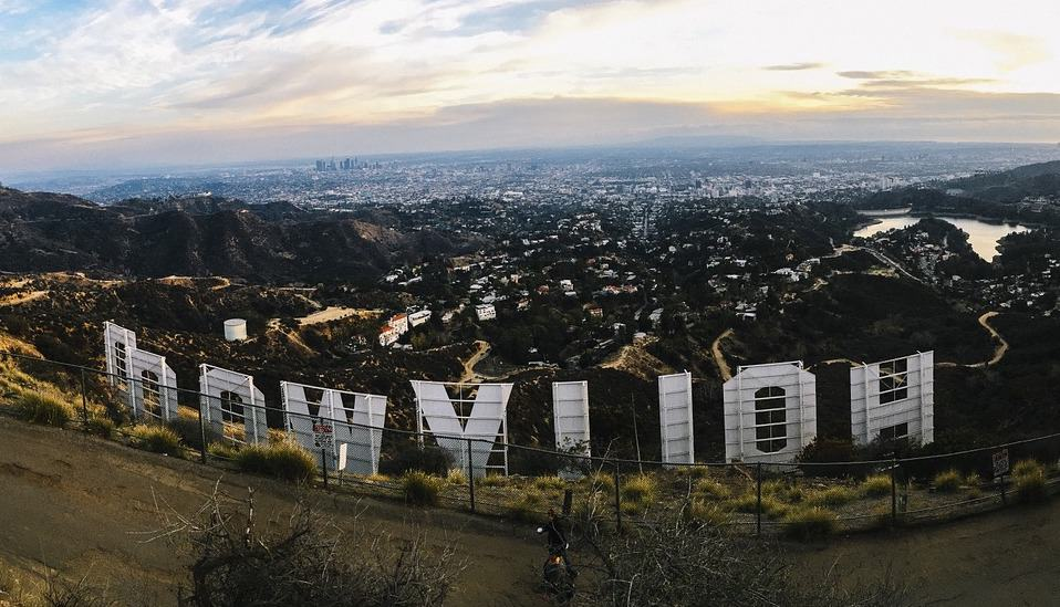 Alt Text: A fisheye photograph of the Hollywood sign from the back at sunset.