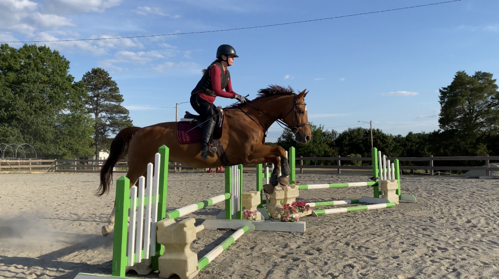I'm riding Leroy while he is mid-jump.